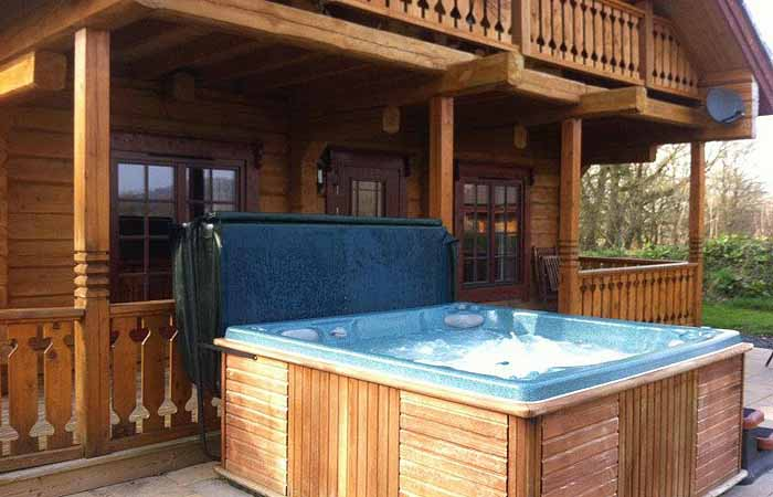 Dwr y felin luxury log house holidays with hot tubs mid Log cabins with hot tubs scotland